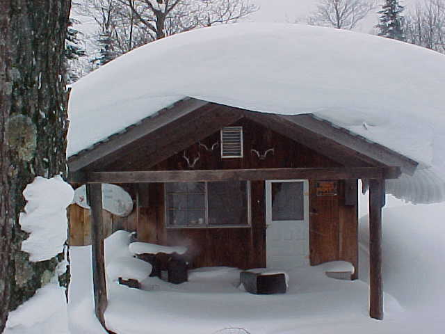 hunting camp covered with snow